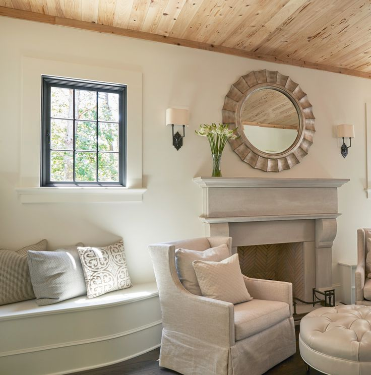 Hearth room with pecky cypress ceiling and limestone fireplace Christopher Architecture & Interiors