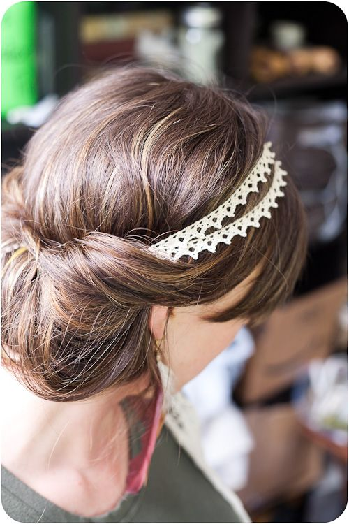 all you have to do is put the headband on top of your hair (while your hair is down) and then grab your hair at the back and tuck it into the headband. The messier the better!