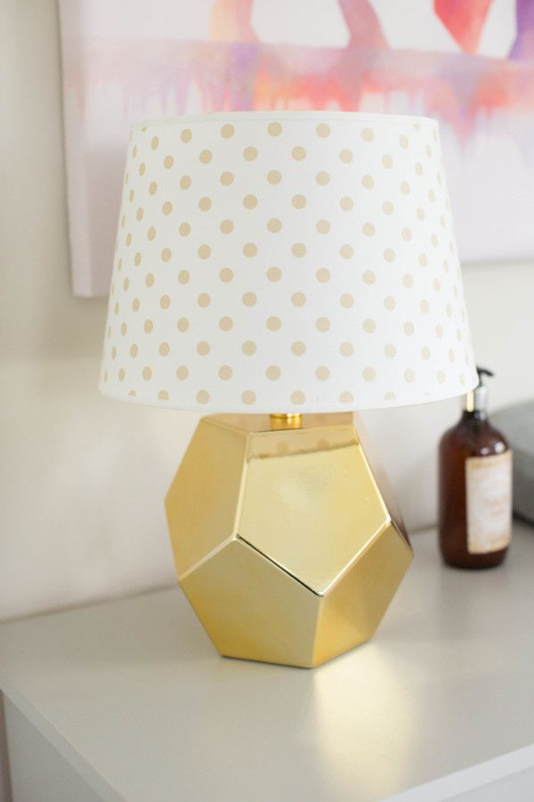 Gold octagon and polka dot nursery decor: http://www.stylemepretty.com/living/2016/11/05/modern-jungle-nursery-in-every-shade-of-pink/ Photography: Melody Melikian - http://www.melodymelikianphotoblog.com/