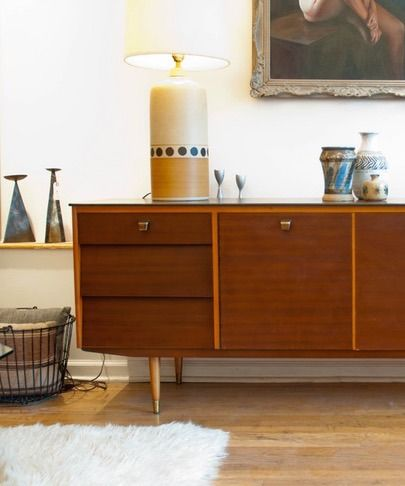 A sleek mid-century modern credenza + vintage accessories and home goods = a well-styled entryway.