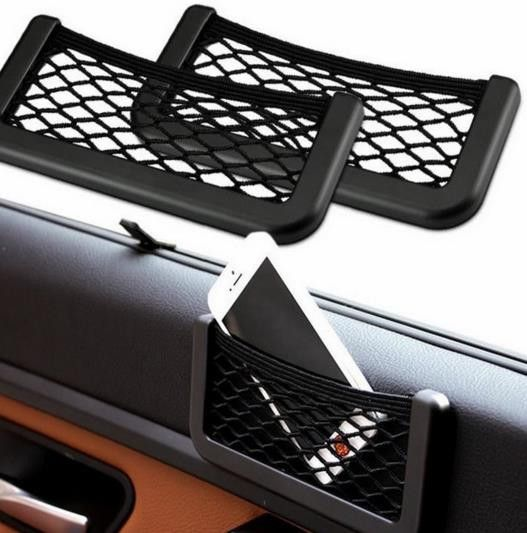 This mini vehicle storage net is pretty cool. It keeps small items in place and can be mounted in a discrete location in your car.