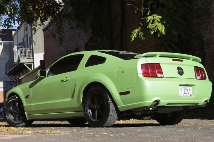 Pearlized Electric Lime Green on y '05 (S197) Mustang GT, with matte black wheels and GT Faux gas cap (rear).