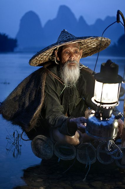 """""""Uncle Pepe"""" by Pathos Photos, via Flickr. #christian_ortiz #pathos_pathos #photography #uncle_pepe #men #blue #light #boats #water #guilin #china"""