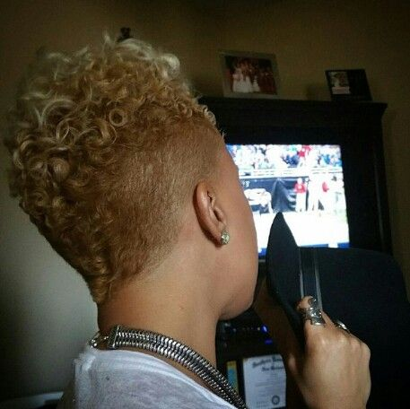 Blonde curls cut in a Mohawk