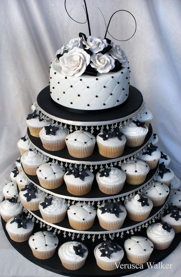 Black White wedding cake atop cupcakes