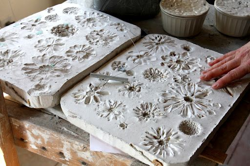 flowers, press them into slabs of wet clay,once the clay hardens they can be used as moulds