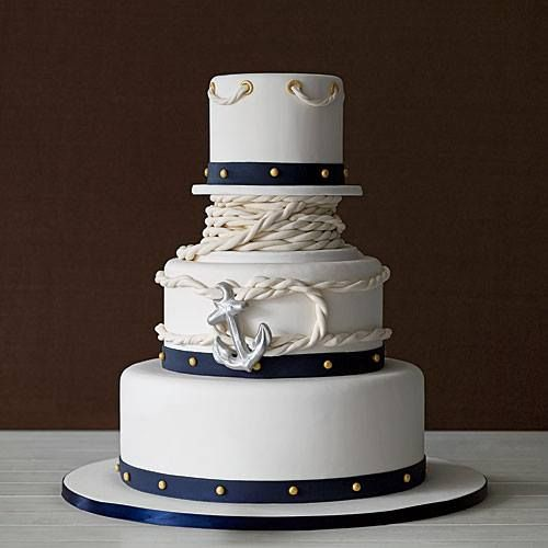 Coastal Wedding Cakes | Anchors Away: Covered| Anchors Away: Covered in white fondant icing with navy bands and gold fondant studs, accented with a sailor's knot and anchor.