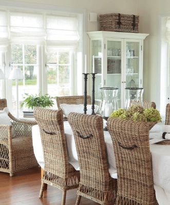 Absolute fave!  White dining with wicker chairs. Divided light French doors and transoms.