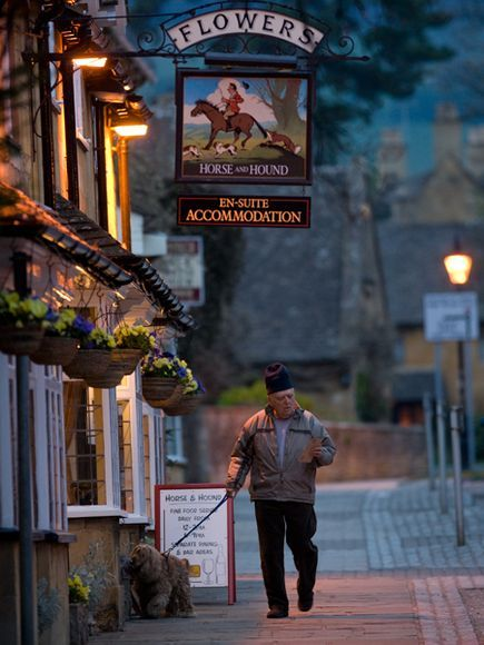 Photo: Pub sign in Cotswold village, England