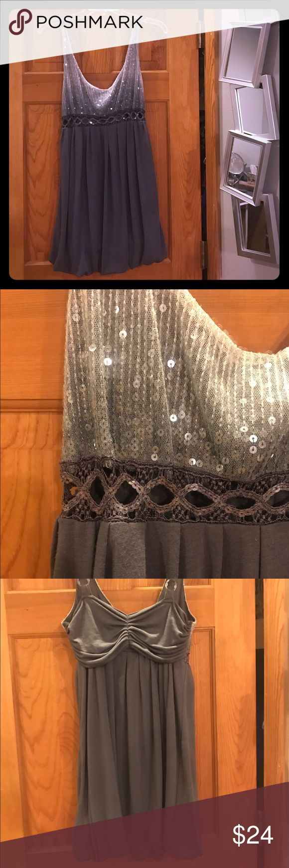 Sequenced Sparkly Dress Charcoal Grey Dress with a light grey to darker grey gradience with Sparkly sequence. Waist has an open belt like design, in the front that shows skin. Mid-thigh length (on me) Cute for New Years Eve! American Rag Dresses Midi
