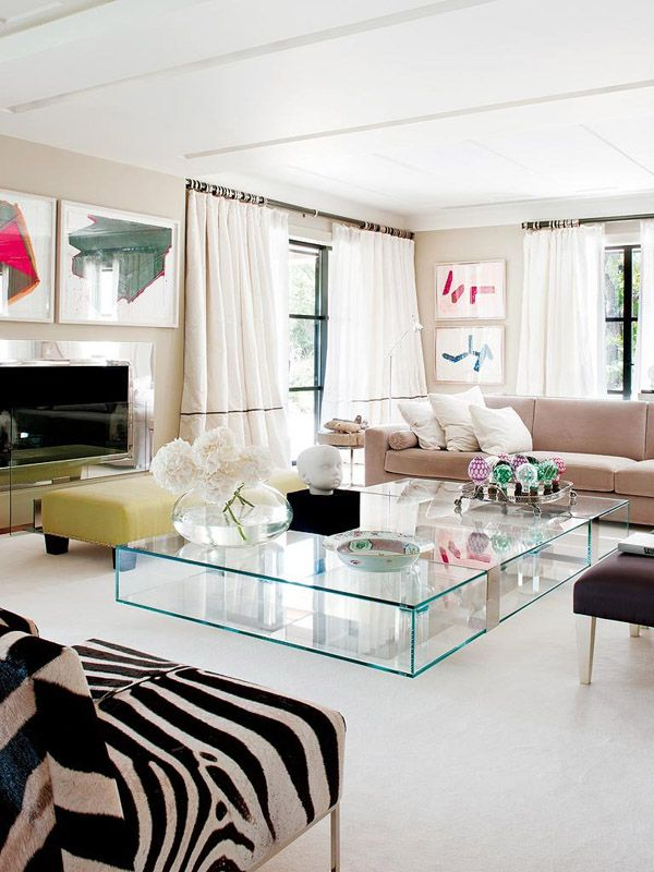 contemporary glam in Portugal living room glass table zebra chairs modern art chrome fireplace