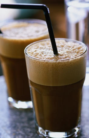 How to make original Greek frappe coffee: In a shaker or jar with a tight-fitting lid add 4 tablespoons of cold water, 1 teaspoon of instant coffee, and sugar to taste (1 teasspoon of sugar for medium-sweet). Close tightly and shake until the mixture appears to be all foam (or even better, you can use an electric drink mixer to do this!). Pour the foam into a tall water glass, add 3-4 ice cubes, milk to taste, fill the rest of the glass with icy cold water and stir. Serve with a straw.