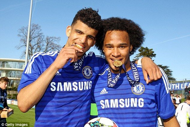 Goal scorersDominic Solanke (left) and Brown pose with their medals in their mouths after sealing victory against Shakhtar Donetsk
