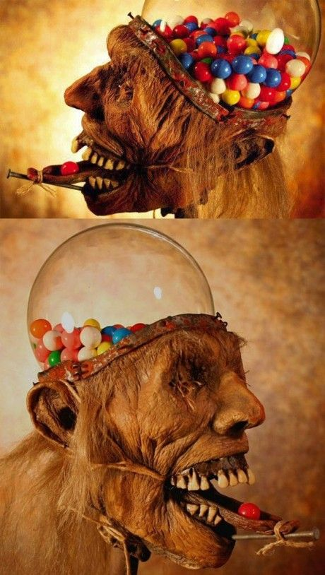 Zombie head gumball machine - This is possibly the most frightening thing I have ever seen.