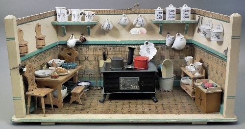 "A 1920s painted wood doll house kitchen by Maurice Gottschalk, 23ins wide x 11ins deep x 11ins high, and a selection of original china and other fitments, and with electric light Note: See Ziliner & Cooper, ""Doll Houses and their Furnishings"", p.95"