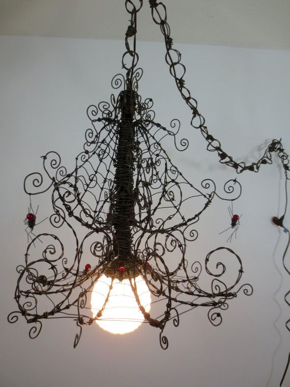 Hanging Barbed Wire Spider Web Chandelier Infested With Spiders by thedustyraven. This is amazing. How cool would this be for your halloween porch!!!!