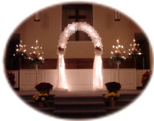 tulle and lights on an arch (minus the ballons in this pic) and candelabra on the side  for the front of the church. ??