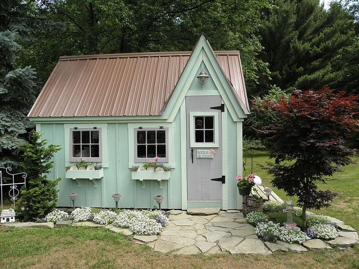 Pinner says: We painted the cottage green with a lighter green for the trim and flower boxes. We used lavender for other accents. There is a double door ...