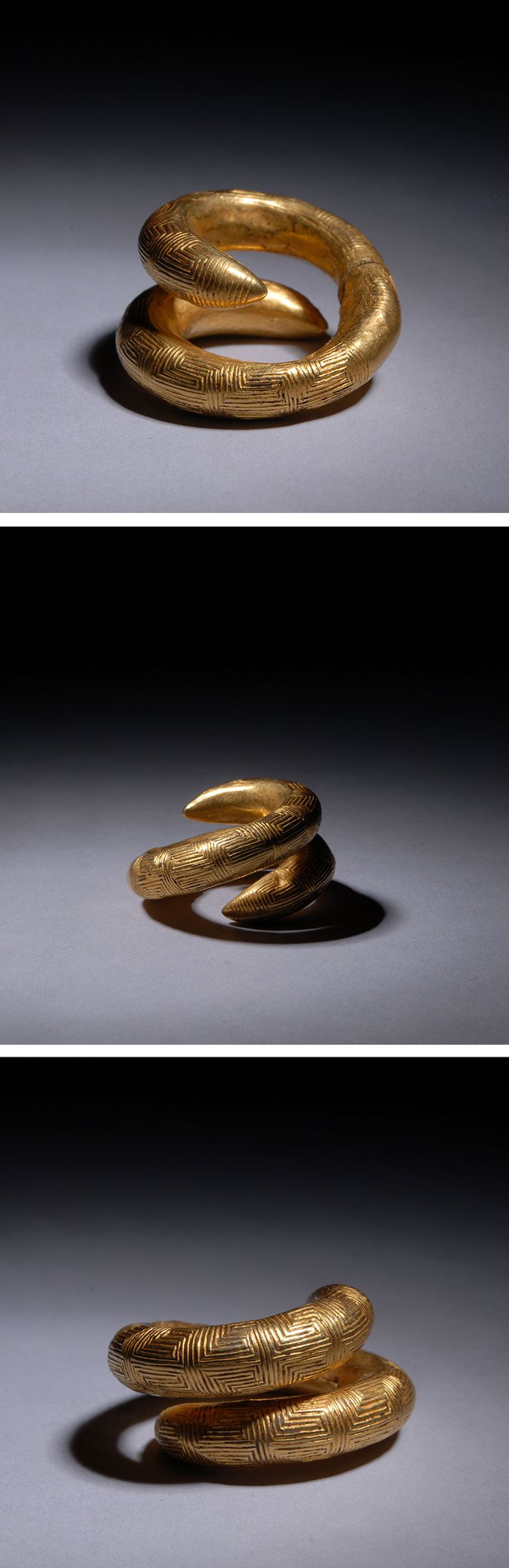 A beautiful ancient Greek gold spiral hair ornament dating to approximately 300 B.C.