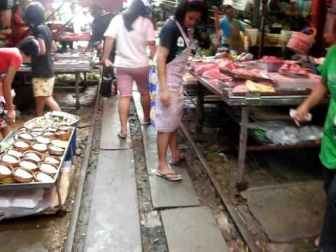 Train pass 7 times In Day, 49 Times In Week -Maeklong Market, Thailand