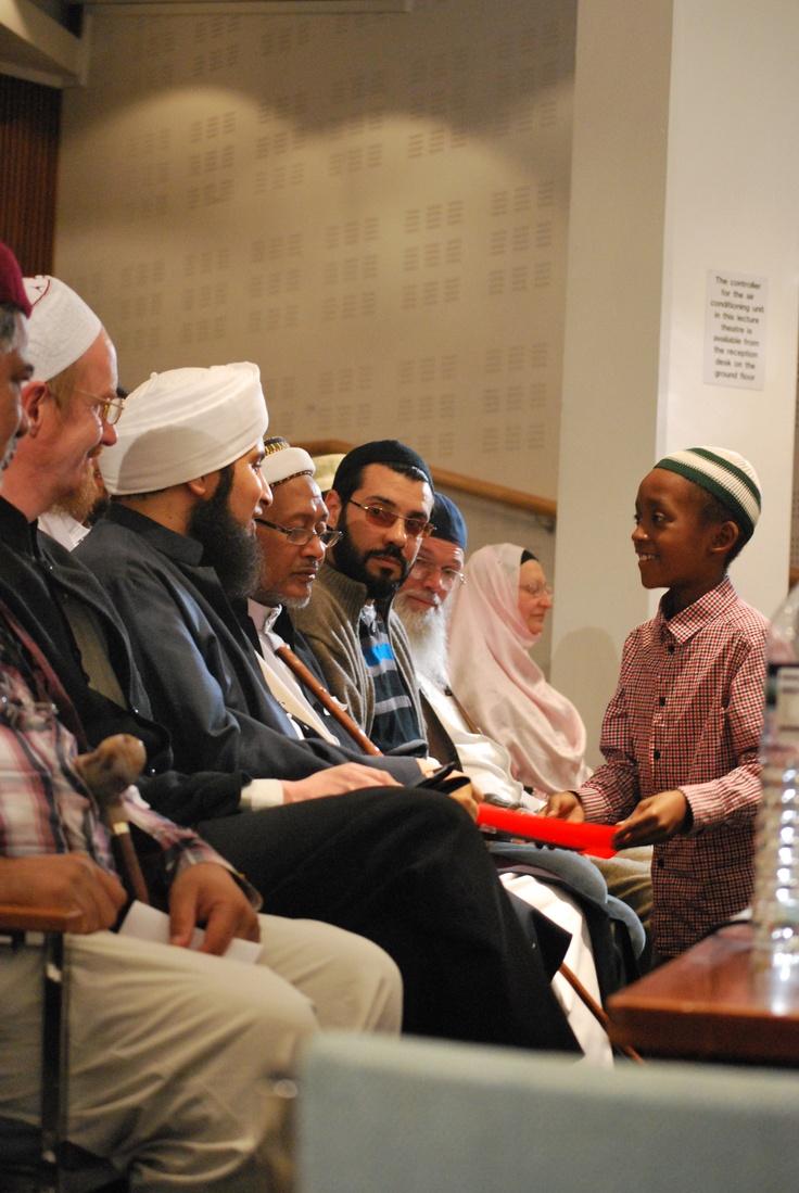 A young audience member speaking to Habib Ali al-Jifri