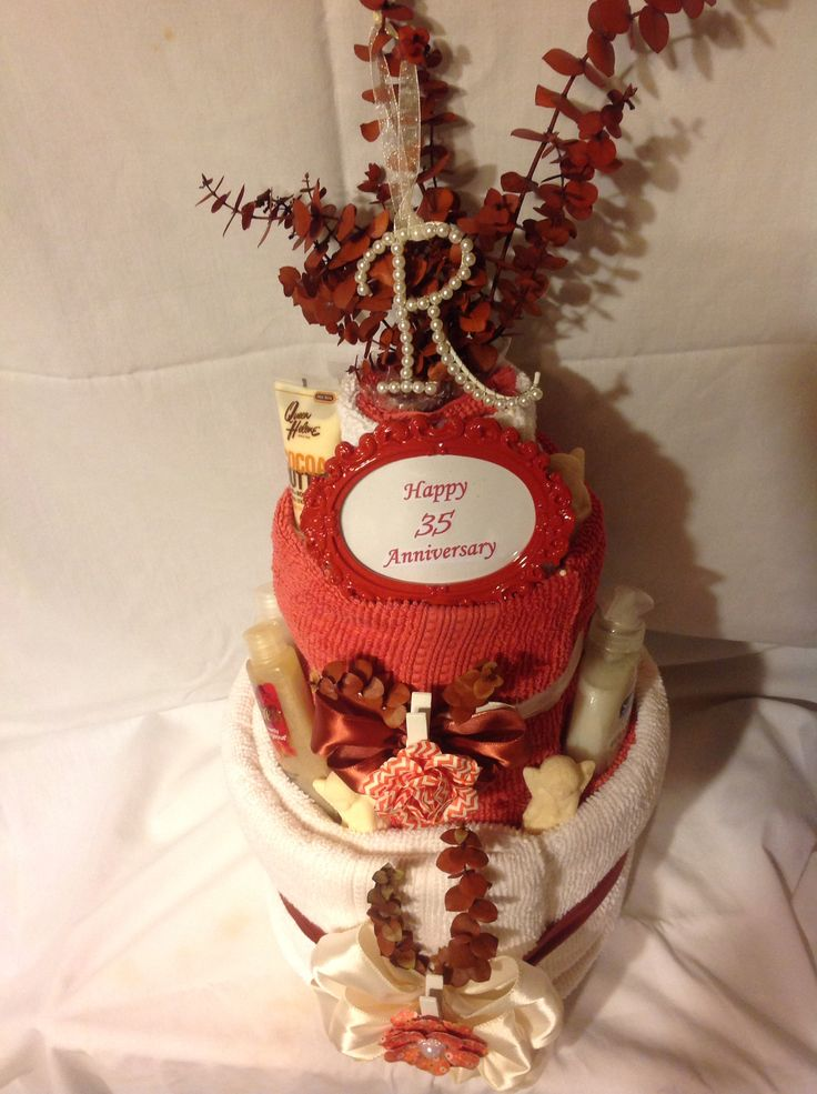 Coral is the 35 th wedding anniversary color.. This is a Bath Towel Cake decorated in coral colors for that perfect gift giving....
