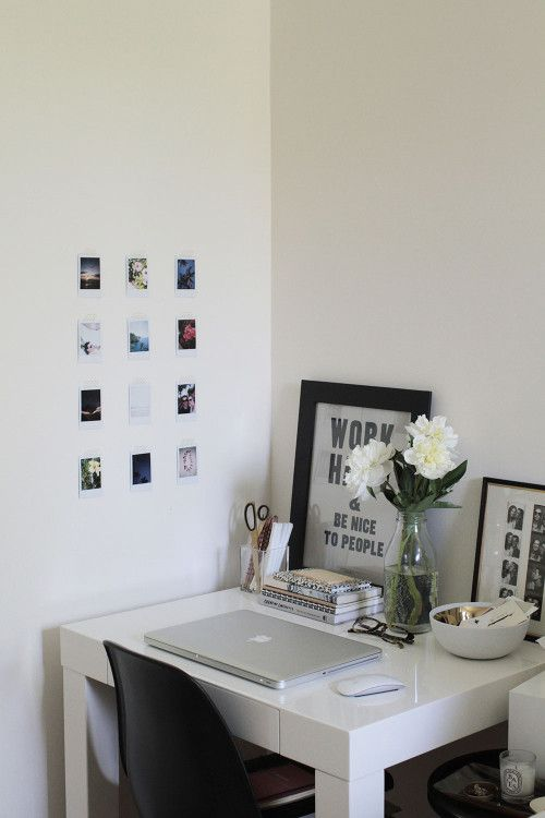 contemporary self contained study space with miniature wall pictures and assortment of desk accessories