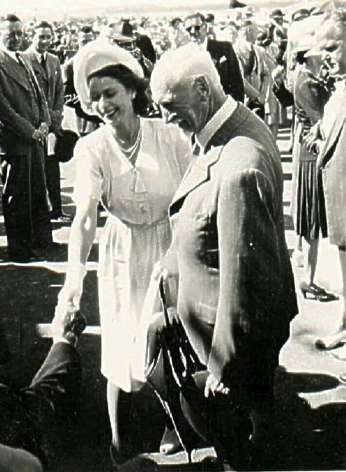 "My mom took this photo in 1947 during Queen Elizabeth's tour of South Africa. It shows Field Marshall Smuts introducing her to some'Oud-Stryders"" of the ABW"