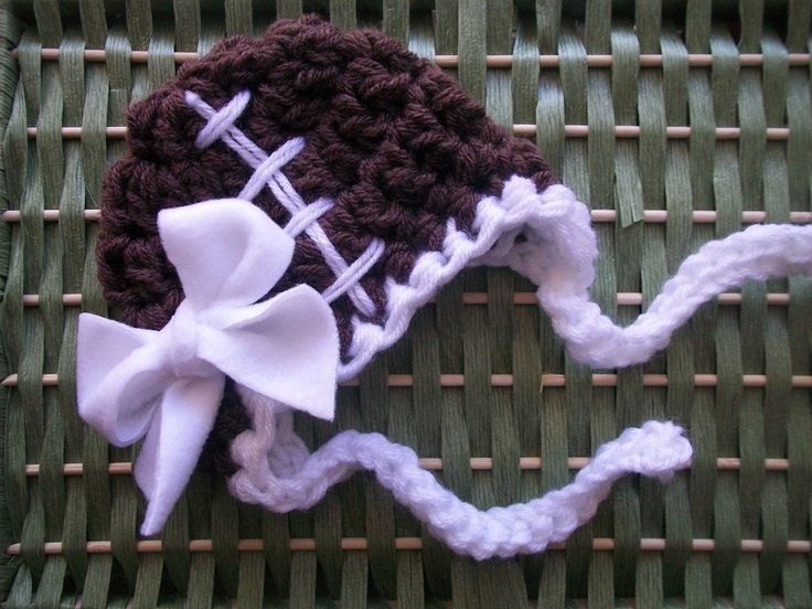 Girl's Football Baby Hat w/ Earflaps and Fleece Bow, Brown and White  -   Many Sizes - Preemie, Newborn, Infant. $12.00, via Etsy.