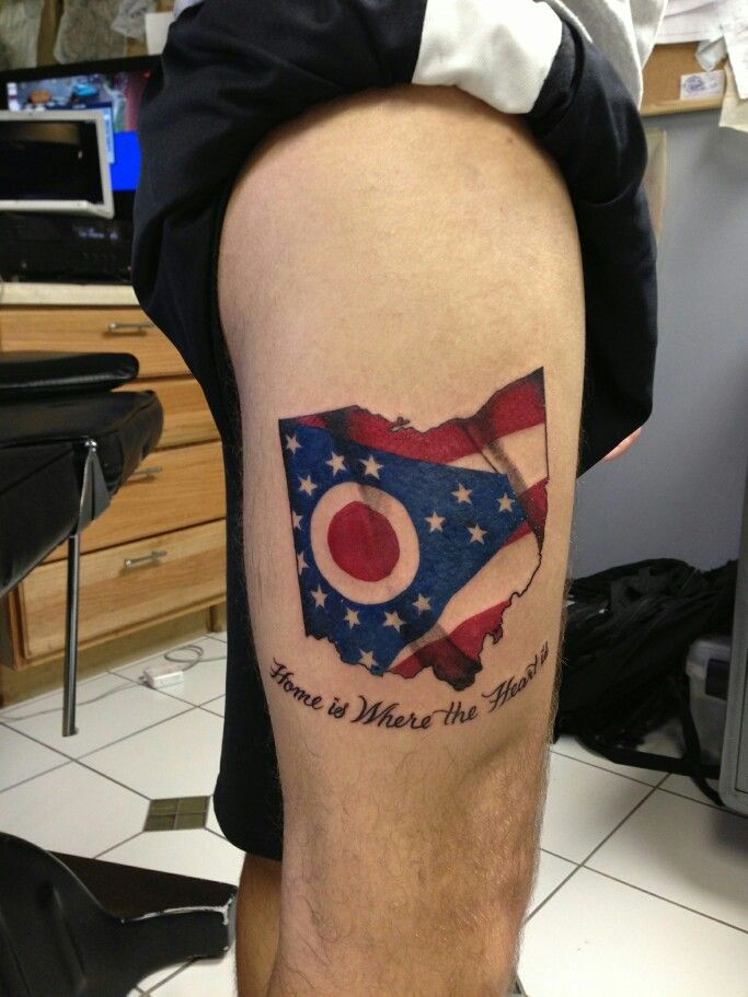 Home is Where the Heart is, state of Ohio with the state flag waiving. Tattoo done by Terry Dutra. In Destin FL.