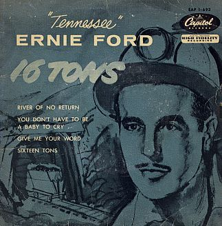 """Record sleeve cover for January 1956 Capitol album that included 'Sixteen Tons' by Tennessee Ernie Ford. The top song in America during late 1955 and early 1956 was a tune about coal mining – a song about the hard life and poverty of being a coal miner.  Its title was """"Sixteen Tons"""" and it was made popular by a singer named Tennessee Ernie Ford."""
