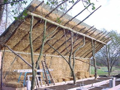 Building a Strawbale Greenhouse, the link contains suggests ways to improve on the design.