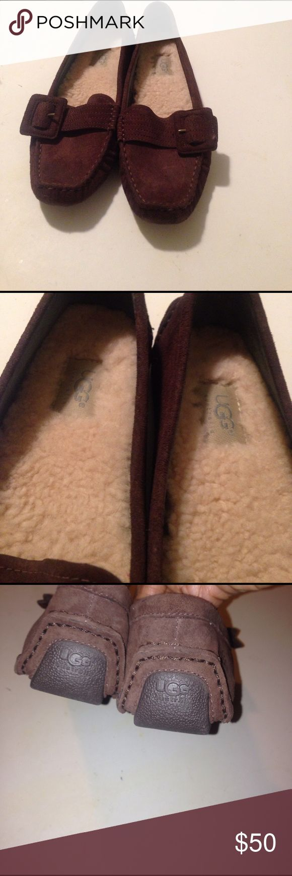 UGG SHOES Flat searing shoes. Buckle detail. Lined in lamb fur. Signature name on side of heels& back. Rubber soles. Minor wear on toe area very comfy & warm UGG Shoes Moccasins