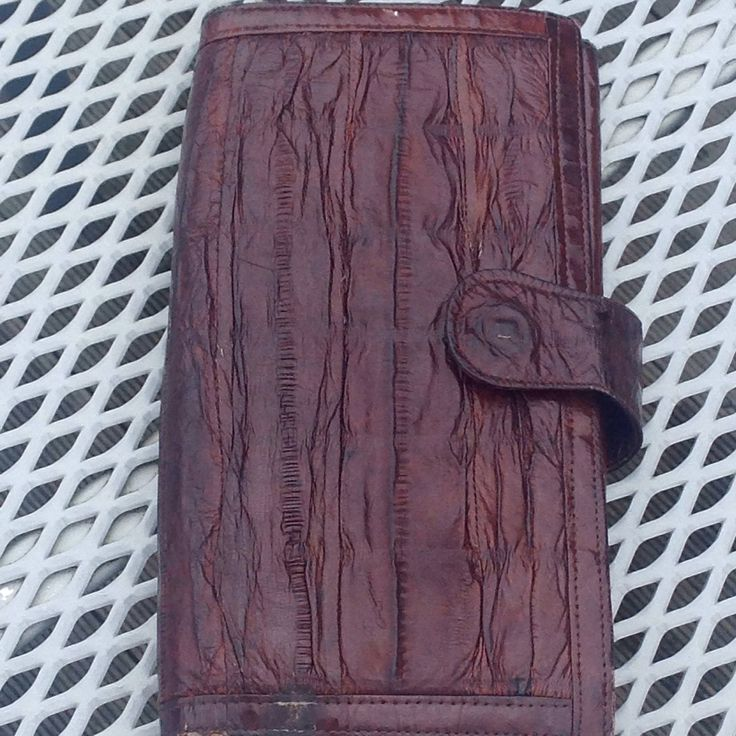 A personal favourite from my Etsy shop https://www.etsy.com/nz/listing/511320128/eel-skin-walletretro-eel-skin-wallet