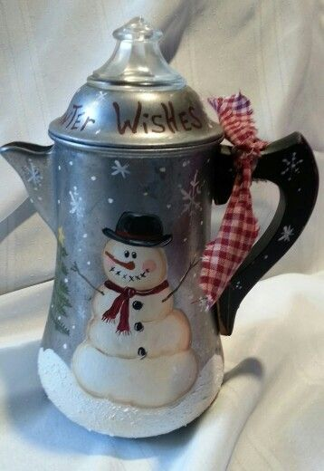 Snowman painted on old coffee pot.