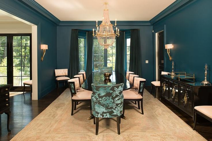 Peacock blue dining room features walls painted peacock for Peacock dining room ideas