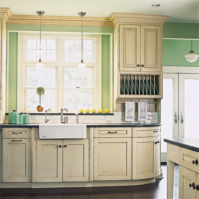 In the late 1800s, a wall-hung cupboard, such as this one with supporting brackets and a cornice on top, would have been paired with furniture-like worktables. | Photo: courtesy of Merillat. |  thisoldhouse.com |