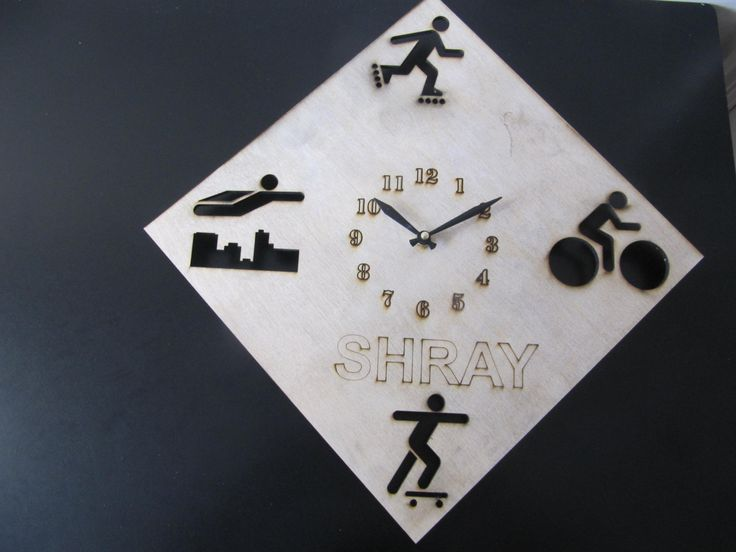Personalized wall clock with logo figures.
