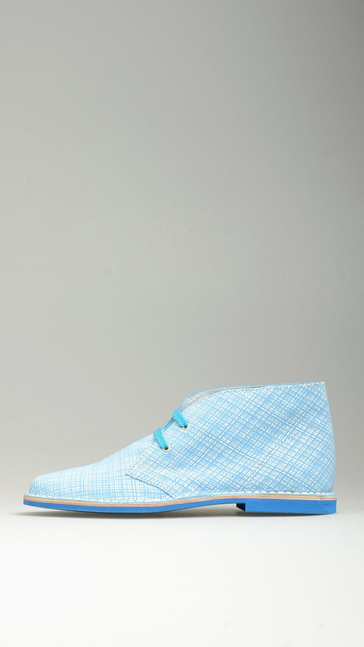 Sky blue suede lace-ups desert boots featuring contrast azure cotton laces, polka-dot lining, desert boots manufacturing process, raw edge stitching, antioxidant eyelets, leather midsole, contrast blue rubber sole,100% high quality suede adn split grain leather.