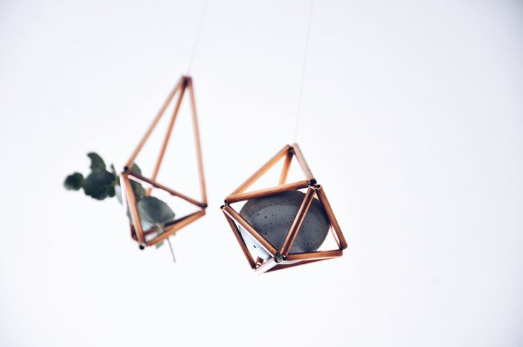 Handmade copper mobiles by Twin, styled wiith petite concrete planter.