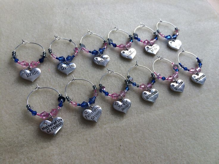 Set of wedding party wine glass charms.  Bespoke orders can be taken at www.handmadecraftcompany.co.uk