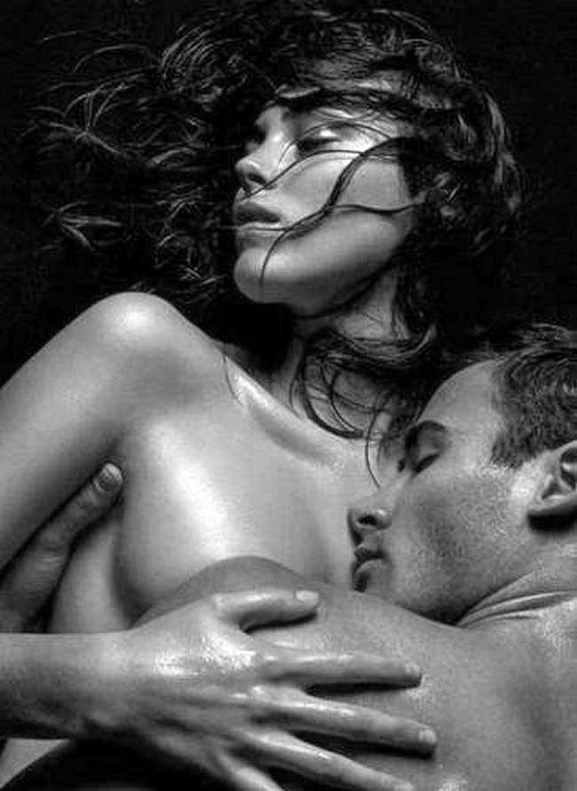 Naked couple sleeping spooning
