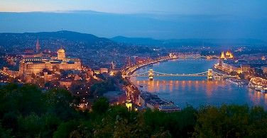 Budapest on the Danube River with the Buda Castle on the left and Hungarian Parliament on the right. Photo via Flickr:Moyan Brenn
