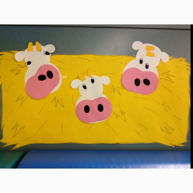 Our farm theme classroom decorations...hay bales with silly cow faces :)