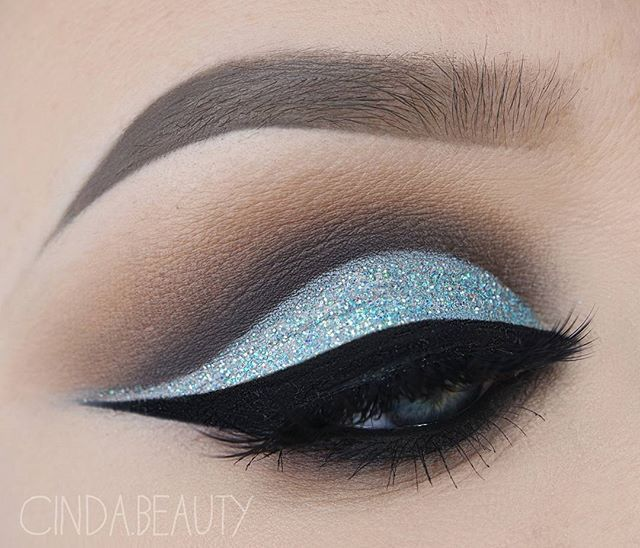 WEBSTA @ cinda.beauty - Frosty Icey Blue Makeup Look with Glitter Used Products: BROWS@anastasiabeverlyhills Dipbrow Pomade in 'Taupe'