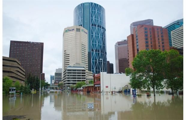 he flooded streets near Riverfront Avenue S.E. and 1st Street S.E. are photographed on Friday, June 21, 2013. Photograph by: Tijana Martin, Calgary Herald