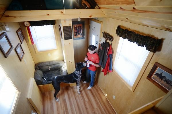 Alicia shares the tiny space with her large Great Dane, Roscoe. Alicia's house was based on a blueprint from the Tumbleweed Tiny House Company and her desire to be mobile and not tied down to high housing costs was the catalyst for this type of home. She also appreciates the low utility costs.