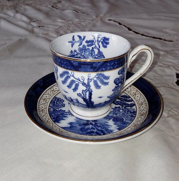 Blue willow tea cup jewelry stand
