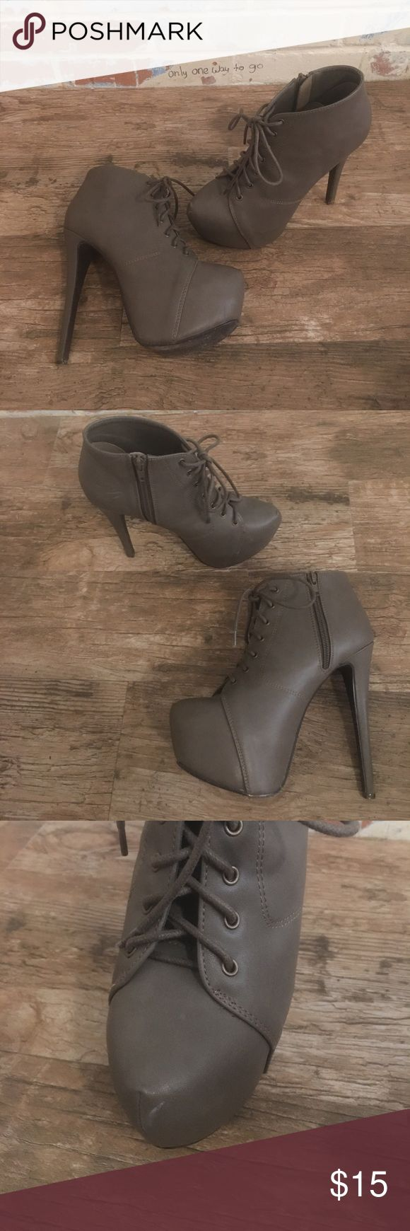 "Women's Charlotte Russe grey booties Like new grey booties are ski high having a 4"" heel and 2"" platform under the toe. They zip up on the side and actually do lace up in the front, not just for decoration. Foot feels comfortably secure however you prefer to adjust it. The only marks on these shoes is due to normal wear and shown in the pictures. Charlotte Russe Shoes Ankle Boots & Booties"