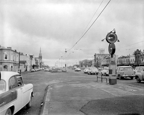 A view along Queen's Parade, Clifton Hill in Melbourne taken in July 1960. A Marshalite traffic control signal is seen on the right